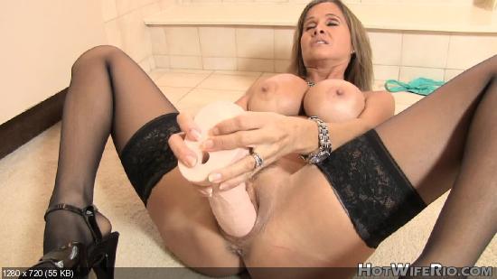 girl sits on huge dildo